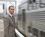 Businessman Beside Train